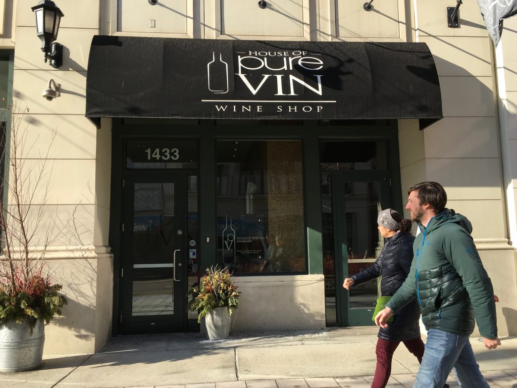 PASSERSBY IN FRONT OF HOUSE OF PURE VIN ON WOODWARD AVE. PHOTO COURTESY OF HOUSE OF PURE VIN