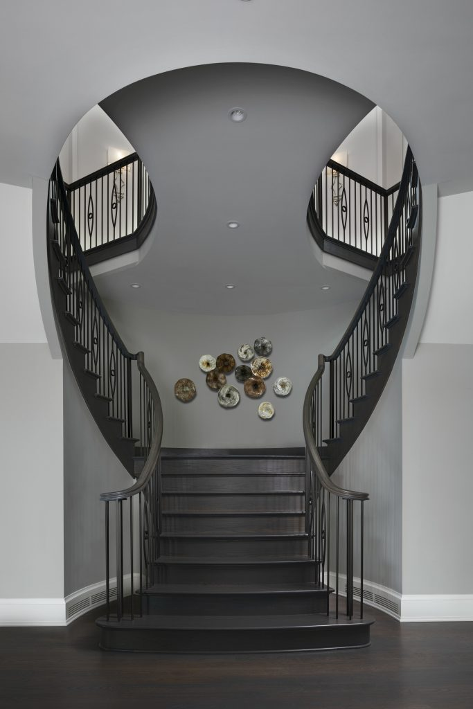 TWIN SPIRAL STAIRCASES CONNECT THE INTERIOR LEVELS OF THIS CUSTOM HOME. PHOTO BETH SINGER