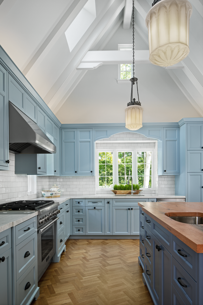 THIS KITCHEN RENOVATION IN A 1920'S HOME COMBINES ART DECO INSPIRED DETAILS - LIKE THE LIGHT PENDANTS - WITH CONTEMPORARY FUNCTIONAL ELEMENTS BUILT INTO THE KITCHEN ISLAND. PHOTO BETH SINGER