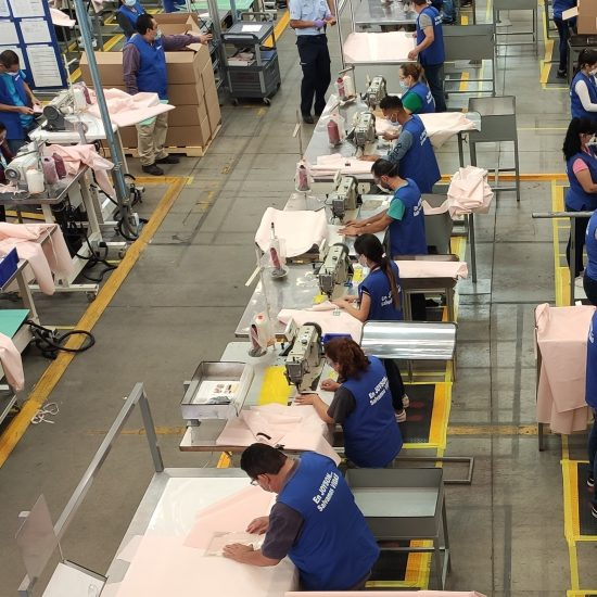 AUTOMAKERS FORD MANUFACTURING REUSABLE GOWNS WITH AIRBAG SUPPLIER JOYSON SAFETY SYSTEMS