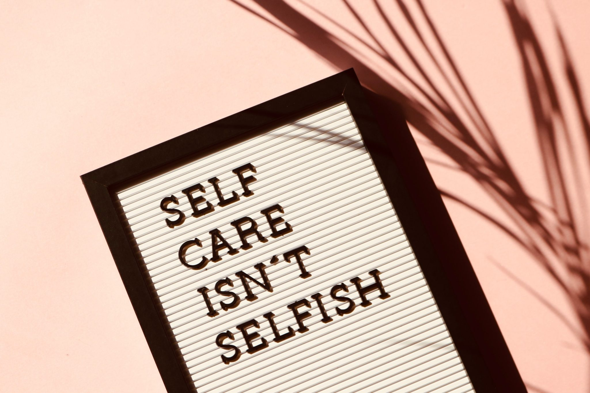OKAY SELF CARE. PHOTO MADISON INOUYE / PEXELS