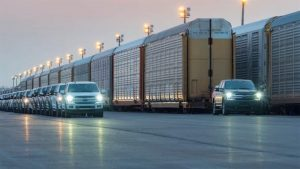 A PROTOTYPE OF THE ALL-ELECTRIC F-150 TOWS A TRAIN