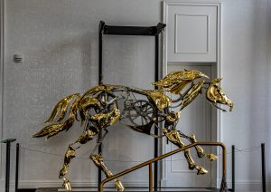 THE GOLD PLATED MECHANICAL HORSE METAL SCULPTURE FROM ARTIST ADRIAN LANDON. PHOTO JOHN BOZICK