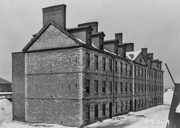 THE FORT WAYNE BARRACKS, 1934. PHOTO FROM THE HISTORIC AMERICAN BUILDINGS SURVEY