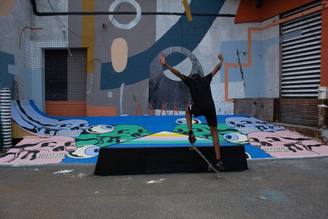A young skater lands a flip